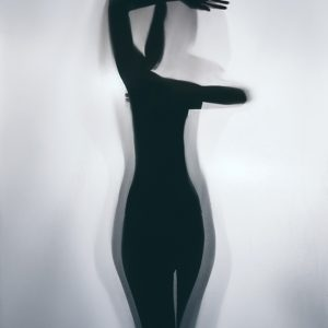Silhouette of young woman on white background – Studio Art Photography