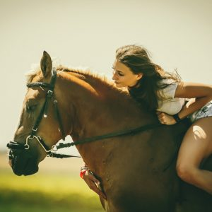 Woman and her horse at sunset – Summer outdoors scene