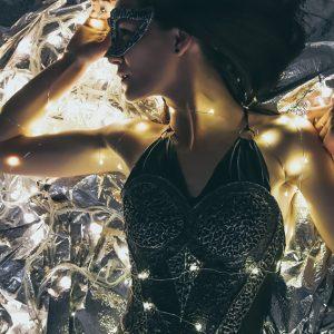 Fashion glamour portrait on the lighting background